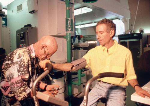 On exercise bike in Biosphere 2's medical laboratory with Dr. Roy Walford. Studies documented the health benefits of our restricted calorie diet and adaptations to lowered atmospheric oxygen.